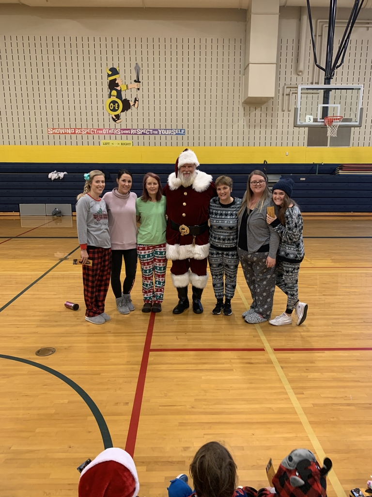Kindergarten teachers enjoyed their visit with Santa.
